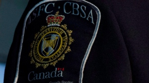 A member of the CBSA is seen here during an announcement on Thursday, Sept. 12, 2013 in Ottawa. (The Canadian Press/Adrian Wyld)