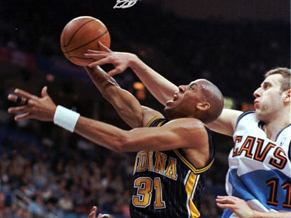 Indiana Pacers guard Reggie Miller (31) drives toward the basket past Cleveland Cavaliers center Zydrunas Ilgauskas (11) in the first quarter Monday, Feb. 8, 1999, at the Gund Arena in Cleveland. (AP Photo/Tony Dejak)