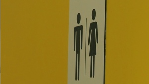 gender neutral washroom sign