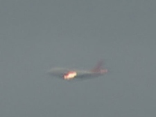 A Sunwing flight prepares for an emergency landing at Pearson International Airport. The plane appears to be on fire.