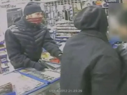 Two suspects in an armed robbery are shown in this surveillance camera image.