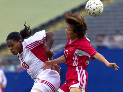 Canada's Charmaine Hooper (10) and China's Lirong Wen (12) vie for the ball during first half action during the consolation game at Women's Gold Cup soccer in Foxboro, Mass. Monday, July 3, 2000. (AP Photo/Elise Amendola)