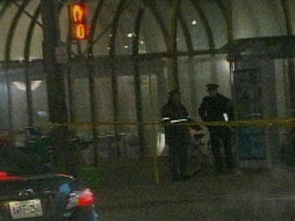 Police are seen outside Dupont Station Sunday night. (CP24)