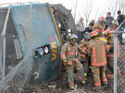 Emergency crews help extract VIA employees from the locomotive out of a train wreck in Burlington, Ont. on Sunday Feb. 26, 2012. THE CANADIAN PRESS/David Ritchie