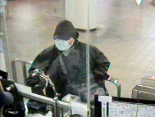 One of four photos that depicts a suspect robbing TTC collectors on various dates. Police believe this suspect is responsible for shooting a TTC staffer at Dupont Station on Feb. 26, 2012.