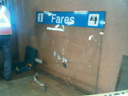 Bullet holes are visible after a failed robbery attempt at Dupont Station on Sunday night.