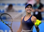 Eugenie Bouchard smiles after winning her women's quarterfinal match against Alize Cornet of France at the WTA Wuhan Open tennis tournament in Wuhan, China's Hubei Province, Thursday, Sept. 25, 2014. (The Canadian Press/AP /Xinhua, Xiao Yijiu)