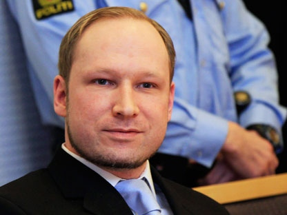 Anders Behring Breivik, a right-wing extremist who confessed to a bombing and mass shooting that killed 77 people on July 22, 2011, arrives for a detention hearing at a court in Oslo, Norway, Monday, Feb. 6, 2012. About 100 survivors and relatives of the victims of the July 22 massacre attended the hearing in Oslo's district court - expected to decide to keep Breivik in jail until his trial begins in April. (AP Photo/Lise Aserud, Scanpix Norway)