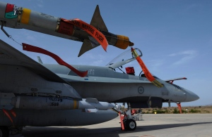 A CF-18 sits loaded for flight at Camp Fortin on the Trapani-Birgi Air Force Base in Trapani, Italy, on Thursday, Sept. 1, 2011. (The Canadian Press/Sean Kilpatrick)