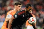 Toronto FC forward Luke Moore defends the ball against Houston Dynamo defender David Horst against the Houston Dynamo during first half MLS soccer action in Toronto on Wednesday, Oct. 8, 2014. (The Canadian Press/Hannah Yoon)