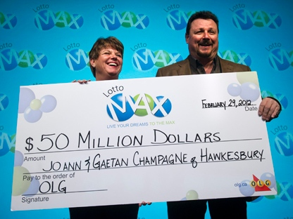 JoAnn Champagne, left, and her husband Gaetan Champagne, winners of a $50-million Lotto Max jackpot, hold a novelty cheque at Ontario Lottery and Gaming Corp. headquarters in Toronto on Wednesday, Feb. 29, 2012. The two won the jackpot on Dec. 30, 2011. (THE CANADIAN PRESS/Nathan Denette)