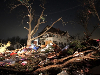 Damage is seen early Wednesday, Feb. 29, 2012, in the town of Harveyville, Kansas, after an apparent tornado passed through the town Tuesday night. (AP Photo/Matthew Fowler, Gazette)