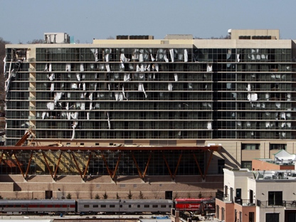 Windows are blown out of a Hilton hotel in downtown Branson, Mo., on Wednesday, Feb. 29, 2012, after a powerful storm system lashed the Midwest. (AP Photo/Mark Schiefelbein)
