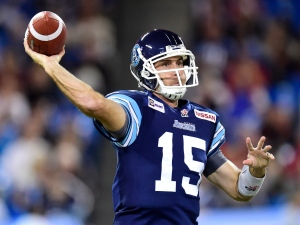 Toronto Argonauts quarterback Ricky Ray throws the ball against the Hamilton Tiger-Cats during first half CFL action in Toronto on Friday, Oct. 10, 2014. (The Canadian Press/Frank Gunn)