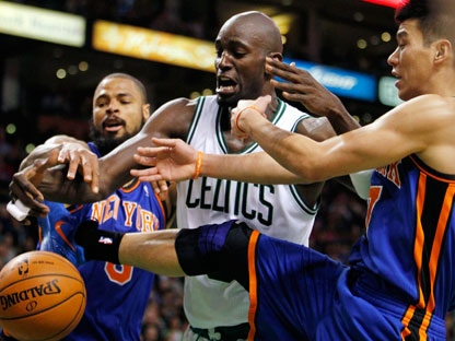 Boston Celtics' Kevin Garnett, center, competes with New York Knicks' Tyson Chandler, left, and Jeremy Lin, right, for a loose ball in the second quarter of an NBA basketball game in Boston, Sunday, March 4, 2012. (AP Photo/Michael Dwyer)