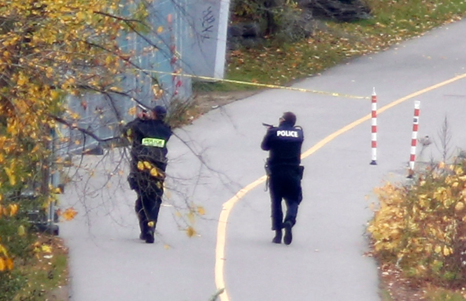 Police search the bike path behind Parliament Hill during an active shooter situation in Ottawa on Wednesday, Oct. 22, 2014. (The Canadian Press/Patrick Doyle)