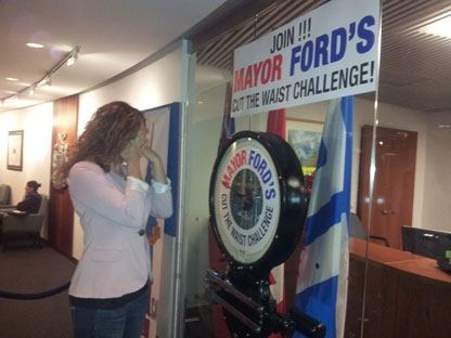 Sandie Benitah refuses to look after she steps on Mayor Ford's 'Cut the Waist' scale.