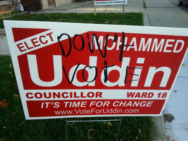 election sign of city council candidate defaced with religious slur