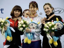 From left, Li Jianrou of China, Cho Ha-ri of South Korea and Canada's Valerie Maltais pose for photographers during the award ceremony of the women's 1,000-meter race at the ISU World Cup short track speedskating championships at Oriental Sports Center in Shanghai, China, Sunday, March 11, 2012. Cho won the gold medal with a time of 1:31.283. Li finished second and Maltais was third. (AP Photo/Eugene Hoshiko)