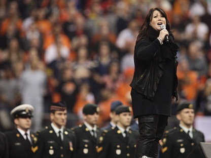 Jann Arden performs the national anthem before the CFL's Grey Cup game, between the Winnipeg Blue Bombers and B.C. Lions, on Sunday, Nov. 27, 2011, in Vancouver. (THE CANADIAN PRESS/Darryl Dyck)