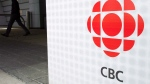 A man leaves the CBC building in Toronto on April 4, 2012. (The Canadian Press/Nathan Denette)