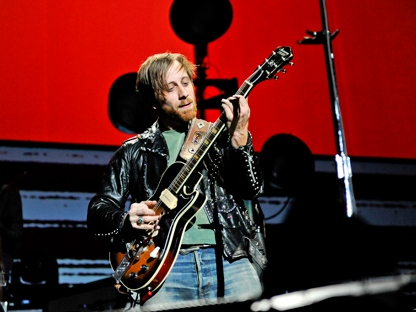 Guitarist and vocalist Dan Auerbach of The Black Keys performs at Madison Square Garden on Monday, March 12, 2012, in New York. (AP Photo/Evan Agostini)
