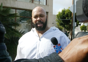 "In this Feb. 26, 2003 file photo, rap music mogul Marion ""Suge"" Knight walks out of the Los Angeles County jail, in Los Angeles. (AP Photo/Damian Dovarganes, File)"