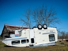 A camper sits upside down on Tuesday, March 13, 2012, on John and Cindy Mikulin's property, who live off M-18 near the Shaffer Road intersection in Coleman, Mich. Severe thunderstorms that moved across the state Monday night spawned a tornado, with property damage and downed trees reported in the Lower Peninsula. The National Weather Service said Tuesday no injuries were reported following the tornado about 6:45 p.m. (AP Photo/The Midland Daily News, Nick King)