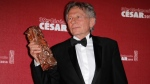 In this Feb. 28, 2014 file photo Polish-French film director Roman Polanski holds his best director award during the 39th French Cesar Awards Ceremony in Paris, Friday Feb. 28, 2014. (AP Photo/Lionel Cironneau)