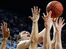 North Carolina's Tyler Zeller shoots over Vermont defenders during the first half of an NCAA tournament second-round college basketball game in Greensboro, N.C., on Friday, March 16, 2012. (AP Photo/Gerry Broome)