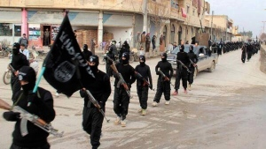This undated file image posted on a militant website on Jan. 14, 2014, which has been verified and is consistent with other AP reporting, shows fighters from the al Qaeda-linked Islamic State marching in Raqqa, Syria. (AP Photo/Militant Website, File)