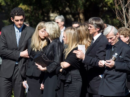 Friends and family of Nik Zoricic embrace each other following his funeral in Toronto on Monday, March 19, 2012. Friends, family and teammates gathered at a Toronto church to pay tribute to the Canadian freestyle skier who died earlier this month after crashing in a World Cup skicross event in Grindelwald, Switzerland. (THE CANADIAN PRESS/Pawel Dwulit)
