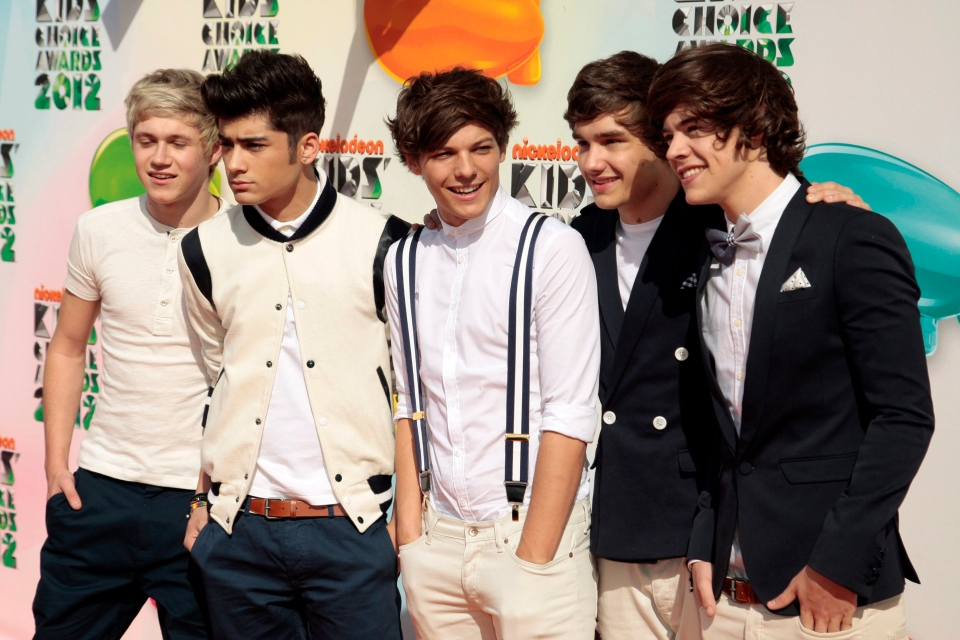 One Direction, from left, Niall Horan, Zayn Malik, Louis Tomlinson, Liam Payne, and Harry Styles arrive at Nickelodeon's 25th Annual Kids' Choice Awards in Los Angeles, Saturday, March 31, 2012. (AP / Chris Pizzello)