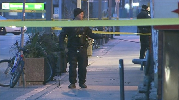 Police investigate the scene at a downtown restaurant in Toronto near Dundas and Chestnut streets after a shooting inside killed one man and sent two women to hospital Sunday, Nov. 16, 2014.