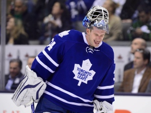 Toronto Maple Leafs goaltender James Reimer winces during a break in play in third period NHL action against the Nashville Predators in Toronto on Tuesday, Nov. 18, 2014. (The Canadian Press/Frank Gunn)