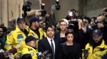 Jian Ghomeshi makes his way through a mob of media with his lawyer Marie Henein (right) at a Toronto court Wednesday, November 26, 2014. The former CBC radio host was granted bail just hours after being charged with multiple counts of sexual assault THE CANADIAN PRESS/Darren Calabrese