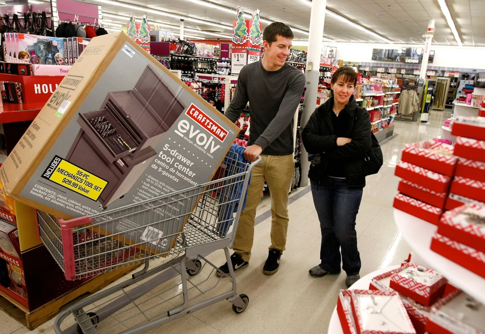 Robyn Paulson and son Brett Reed shop at K-Mart on Black Friday in Roseburg, Ore., Friday Nov. 28, 2014. (AP /The News-Review, Michael Sullivan)
