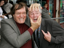 "Actor Richard Kiel, left, who played the role of Jaws in ""The Spy Who Loved Me,"" jokes around with Los Angeles City Councilman Tom LaBonge during a ceremony honoring Roger Moore with a star on the Hollywood Walk of Fame on Thursday, Oct. 11, 2007, in the Hollywood section of Los Angeles. (AP Photo/Mark J. Terrill)"
