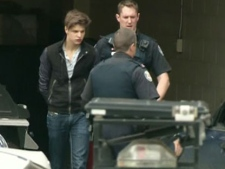 Oliver Karafa, 19, leaves a Toronto court on Tuesday, April 3, 2012. (CTV)