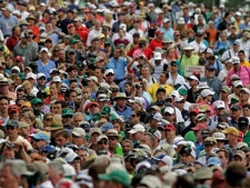 Spectators leave Augusta National Golf Course after play was suspended because of inclement weather during the par 3 competition at the Masters golf tournament Wednesday, April 4, 2012, in Augusta, Ga. (AP Photo/Darron Cummings)