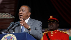 Kenyan President, Uhuru Kenyatta, delivers his speech, during Mashujaa Day, at the Nyayo Nationa Stadium, in Nairobi, Kenya, Monday, Oct. 20, 2014. (AP Photo/Khalil Senosi)