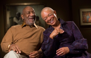 "In this Nov. 6, 2014 file photo, entertainer Bill Cosby and his wife Camille laugh as they tell a story about collecting one of the pieces in the upcoming exhibit, ""Conversations: African and African-American Artworks in Dialogue,"" at the Smithsonian's National Museum of African Art in Washington. (AP Photo/Evan Vucci)"