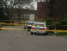 Evidence markers are pictured on the ground on Northmount Avenue, near Bathurst and Wilson, on Monday, April 16, 2012, after a Toronto police officer was stabbed and a man shot during an altercation the night before. (CTV/Tamara Cherry)
