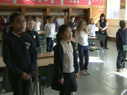 A Toronto Catholic District School Board trustee wants kids to sign O Canada without music every morning.
