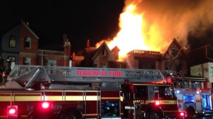 Flames can be seen shooting through the roof of the Sotto Sotto and Spuntini restaurants on Avenue Road near Davenport Road on the evening of Dec. 25, 2014. (Tom Podolec/CTV News)