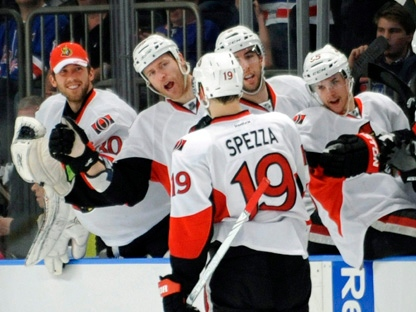 Teammates greet Ottawa Senators forward Jason Spezza after his empty-net goal during the third period of Game 5 of an NHL Stanley Cup first-round playoff series against the New York Rangers, Saturday, April 21, 2012, at New York's Madison Square Garden. The Senators won 2-0. (AP Photo/Bill Kostroun)
