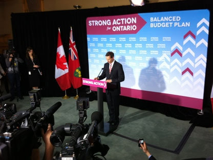 Premier Dalton McGuinty speaks to reporters about the 2012 budget on April 23, 2012. (Mathew Reid/CP24)