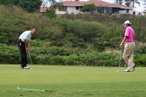 President Barack Obama plays golf with Malaysian Prime Minister Najib Razak, right, Wednesday, Dec. 24, 2014, at Marine Corps Base Hawaii's Kaneohe Klipper Golf Course in Kaneohe, Hawaii during the Obama family vacation. (AP Photo/Jacquelyn Martin)