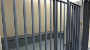A picture of a jail cell is shown in this photo.