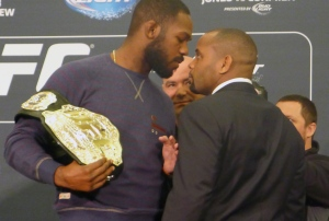 UFC light-heavyweight champion Jon (Bones) Jones, left, and challenger Daniel (DC) Cormier get up-close and personal during a staredown in advance of UFC 182, in Las Vegas on Thursday, Jan. 1, 2015. (The Canadian Press/Neil Davidson)